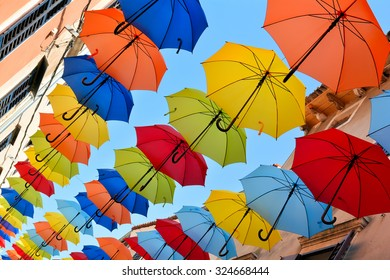 Umbrellas on a shopping street in the old town of Novigrad in Croatia