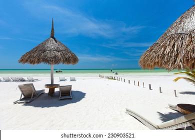 Umbrellas on stunning tropical beach at Holbox Mexico