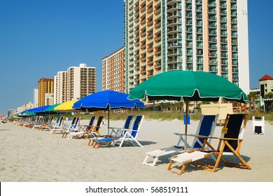 Umbrellas in a row along the Grand Strand of Myrtle Beach