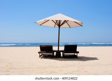 Umbrellas and sunbeds on the beach of Nusa Duo.The Island Of Bali Indonesia