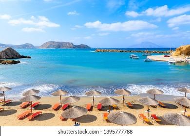 Umbrellas and sunbeds on beautiful Finiki beach, Karpathos island, Greece