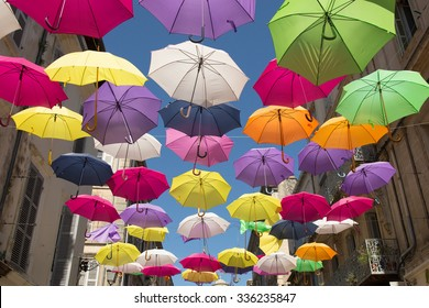 umbrellas suspended in the streets of Arles, France