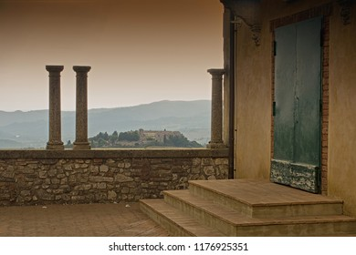 Umbria, Italy - August 12 2018: Romantic view with colums, door and country village