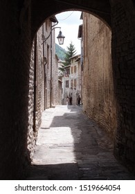 UMBRIA, ITALY, August 2016: touristic trip. Travel view of Gubbio featuring alley arc. The image location is Umbria in Italy, Europe.