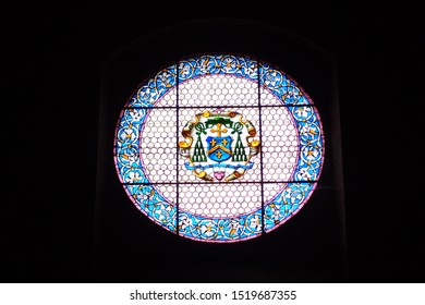 UMBRIA, ITALY, August 2016: touristic trip. Travel view of Gubbio featuring church window glass. The image location is Umbria in Italy, Europe.