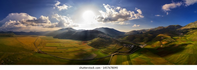 Umbria, Italy, cultivated and flowery fields of Pian Piccolo near Castellucio di Norcia; colorful aerial view of the flowers fields with spots of light