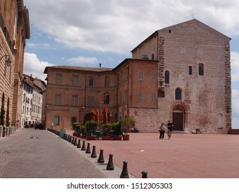 UMBRIA, ITALY - June 2019: Travel view of Gubbio. Some houses can be seen, the sky is cloudy.It is summer time.