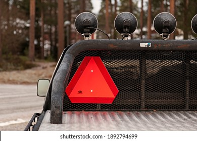 Umea, Norrland Sweden - December 1, 2020:warning triangle for slow-moving vehicles
