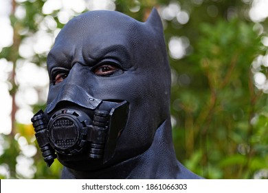 Umea, Norrland Sweden - September 5, 2020: Batman with breathing mask in the forest