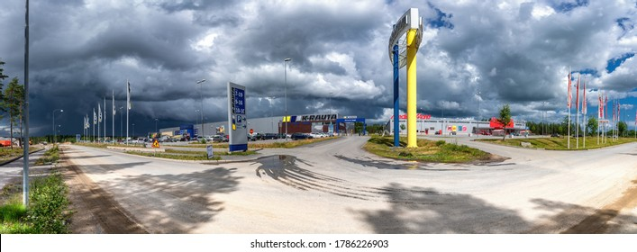 Umea, Sweden - JULY 09, 2020: Panorama view on K-Rauta and Media Markt large shops and parking lot in Klockarbacken shopping area. Heavy summer clouds. Logo of K-Rauta and Media Markt on the shops.