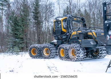 Umea, Sweden NOVEMBER 10, 2019: High performance modern forestry machine for forest cutting, stacking and logging, delivering peak efficiency and productivity for specific forestry tasks. Winter