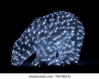 UMEA, SWEDEN ON DECEMBER 20. Mini polar bear in plastic lighted of small lamps on December 20, 2017 in studio, Sweden. Dark background, Illustrative editorial.