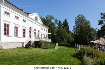 UMEA, SWEDEN ON JULY 26. View of the Baggbole mansion in bright sunshine on July 26, 2017 in Baggbole, Umea, Sweden. Café and outdoor restaurant on the balcony.