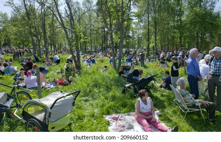 UMEA, SWEDEN ON JUNE 06. People celebrating the Swedish National Day on June 06, 2014 in Umea, Sweden. Unidentified people in a park next to Gamlia Homestead.