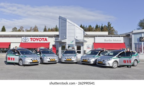 UMEA, SWEDEN ON SEPTEMBER 13. Five new Toyota Prius Plus this side the local reseller of Toyota on September 13, 2012 in Umea, Sweden. Eco Taxi, a local partner on 911911 for a cab.