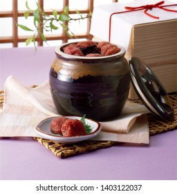 Umeboshi are dried, salt-pickled Japanese apricot. They taste salty, and are extremly sour.