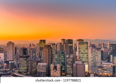 Umeda city central business downtown with after sunset sky background, Japan