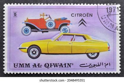 Umm al - Qaiwain - circa 1972 : Cancelled postage stamp printed by  Umm al-Qaiwain, that shows Old and new version of Citroen vehicle, circa 1972.