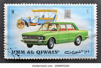 Umm al - Qaiwain - circa 1972 : Cancelled postage stamp printed by  Umm al-Qaiwain, that shows Old and new version of Fiat vehicle, circa 1972.
