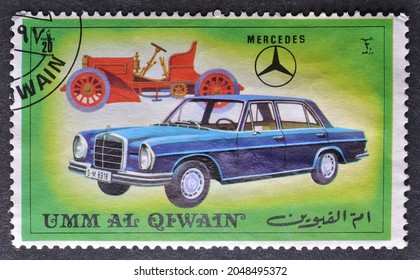 Umm al - Qaiwain - circa 1972 : Cancelled postage stamp printed by  Umm al-Qaiwain, that shows Old and new version of Mercedes vehicle, circa 1972.