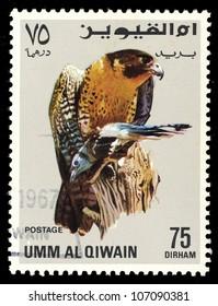 UMM AL QIWAIN - CIRCA 1968: A stamp printed in Umm Al Qiwain shows eagle, series devoted to the birds, circa 1968