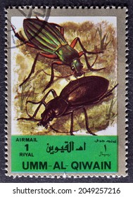 Umm Al Qiwain - circa 1972 : Cancelled postage stamp printed by Umm Al Qiwain, that shows insects, circa 1972.