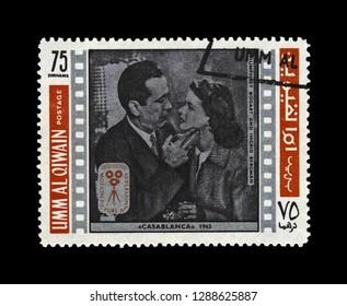 UMM AL QIWAIN, UNITED ARAB EMIRATES - CIRCA 1970s: canceled stamp printed in UAE shows Casablanca film scene: Ingrid Bergman (Ilsa Lund) and Humphrey Bogart (Rick Blaine), circa 1970s.