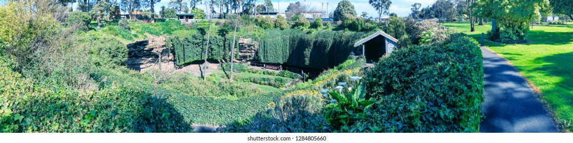 Umpherston Sinkhole Park in Mt Gambier, Australia. Panoramic view on a sunny day.