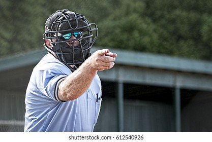 Umpire in blue uniform calls a strike