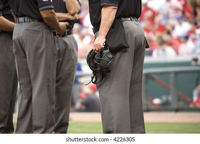 umpire crew meets before the game at home plate
