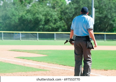 Umpire standing on a baseball field with copy space
