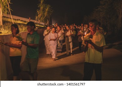 (Un focus on Unidentify people) Wat Bunglatthiwan, Ayutthaya, Thailand - May 2019 : Vesak Day Activity by Buddhism faith on Buddhist ceremony, People walk with lighted candles in hand around temple.