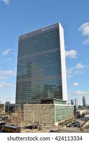 UN Headquarters Building against a blue sky.