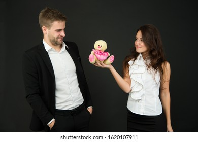 Unacceptable initiative. Love and romance. Gift with love. Couple on romantic date. Formal couple with toy. Man and woman corporate attire fashion. Couple in love celebrate valentines day. Surprise.