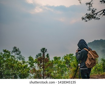 Unacquainted Tourist waiting for sunrise in early morning at Phu Kradueng mountain national park in Loei City Thailand.Phu Kradueng mountain national park