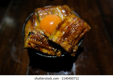 Unadon an abbreviation for unagi + donburi, eel bowl) is a dish originating in Japan. It consists of a donburi type large bowl filled with steamed white rice, and topped with fillets of eel (unagi).
