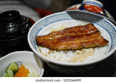 Unadon (an abbreviation for unagi + donburi) - It consists of a donburi type large bowl filled with steamed white rice, and topped with fillets of eel (unagi)
