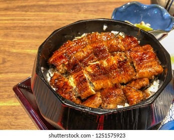 Unagi donburi's a dish originating in Japan, a bowl filled with steamed white rice,topped with fillets of eel (unagi),glazed with a sweetened soy based sauce, called tare and caramelized.