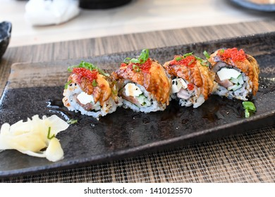Unagi maki roll with tobiko in japanese restaurant , japanese eel with rice roll and fish roe