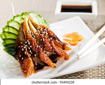 unagi Sashimi. Garnished with Ginger, Wasabi, Cucumber, Salad Leaf and Lemon