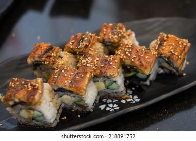 Unagi sushi on black dish