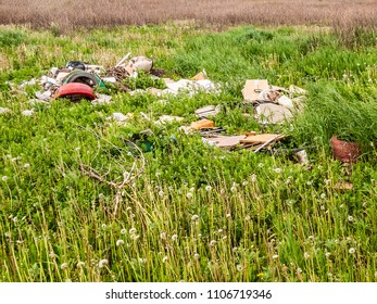 Unauthorized garbage dump on the green grass