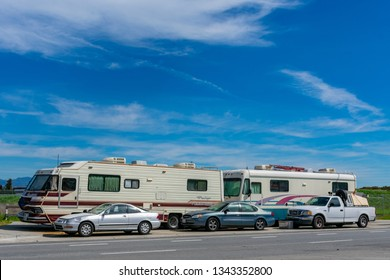 Unauthorized homeless encampment - RVs, trailers and cars parked along public street in Silicon Valley -  San Jose, California, USA - March 17, 2019