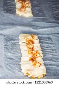 Unbaked raw pecan danish butter dough, wiener