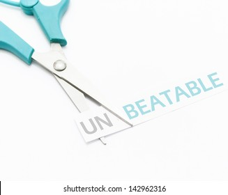 un-beatable conceptual image with scissors on white background