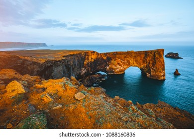 Unbelievable arch of lava standing in the sea on small peninsula. Location Sudurland, cape Dyrholaey, Iceland, Vik village, Europe. Scenic image of Atlantic ocean. Discover the beauty of earth.
