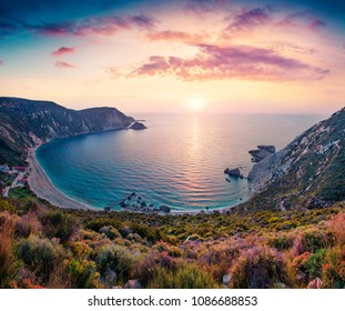 Unbelievable spring view of Petani Beach. Great sunset on Cephalonia Island, Greece, Europe. Beautiful evening seascape of Mediterranen Sea. Fantastic outdoor scene of Ionian Islands.