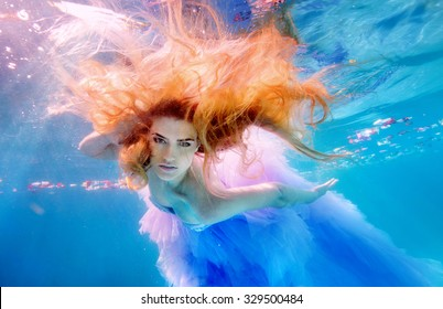 Unbelievable underwater beauty red-head girl in fabulous dress. Real shot.