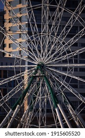 Unbelievable view on the houses through Ferris wheel. Amazing geometry of circles and lines
