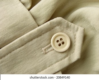 unbleached linen clothes fragment with button